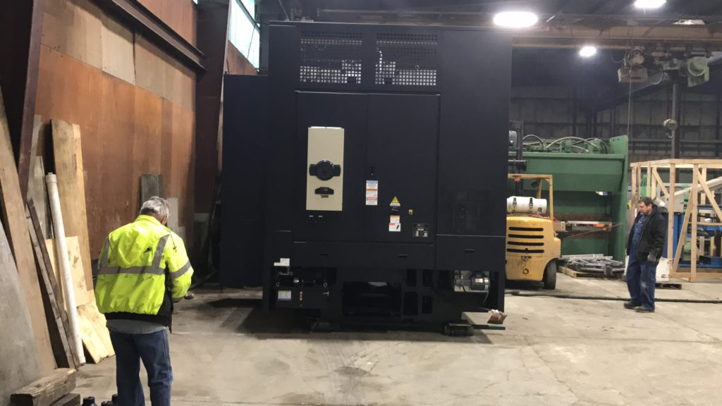 Using our Hilman Traksporter to move 50,000 lbs. Hwacheon VTL